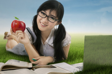 Attractive student studying at field 1