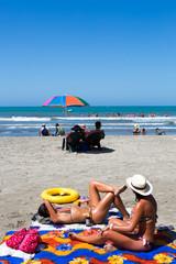 Girls sun bathing on the beach