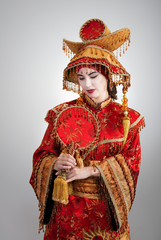 Woman in Chinese princess costume with a fan