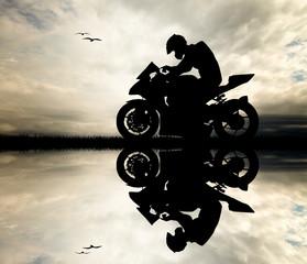 Wall Mural - Man motorcyclist at sunset