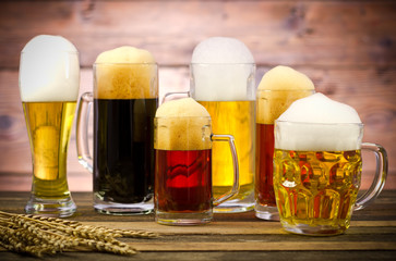 Variety of beer glasses on a wooden table
