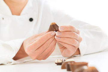 Women chef holding a Chocolate Candy