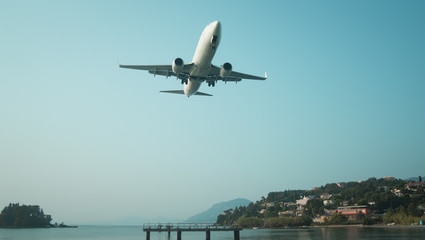 Plane landing on summer vacation or business travel
