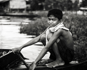 Poor Boy On a Boat in Cambodia