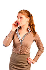 Slim pretty girl in office clothes with a phone