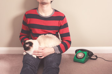 Man with cat and telephone