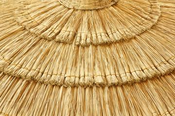 straw beach umbrella close-up