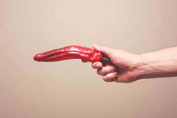 Holding a red pepper