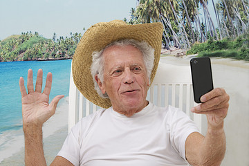 Mature man in vacation taking a picture of himself