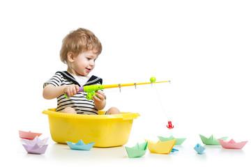 Kid boy plays fishing