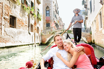 Wall Murals Gondolas Romantic travel couple in Venice on Gondole boat