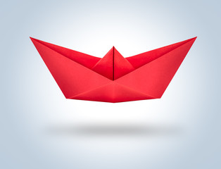 Red origami paper ship.