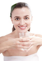 Smiling happy woman holding the glass of water.