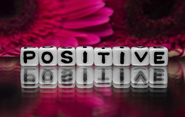 Positive text with flowers