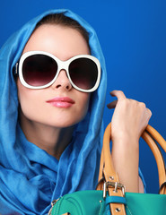 Portrait of an attractive young woman in sunglasses. Retro style
