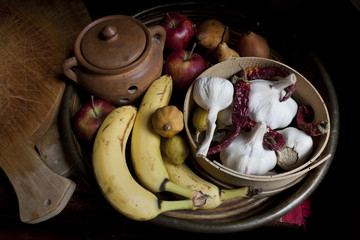 still life with fruits and vegetables with rustic backround