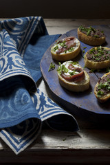 canapes with anchovies and olive paste with parsley