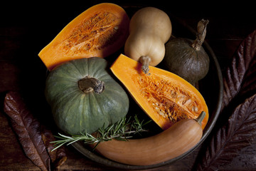 variety of pumpkins with rustic autumnal background