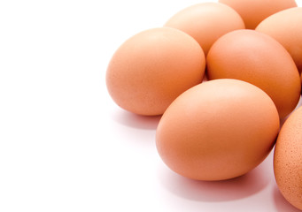 Brown chicken eggs isolated on a white background