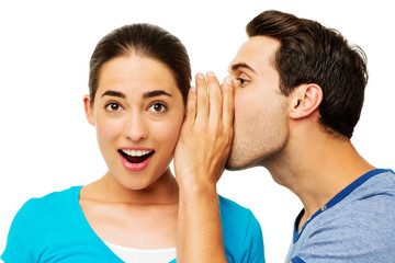 Man Sharing Secret With Surprised Woman