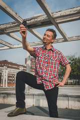 Man in short sleeve shirt taking a selfie