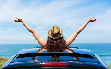 Woman on car travel freedom enjoying freedom