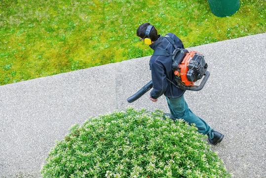 gardener using a gas blower in a park
