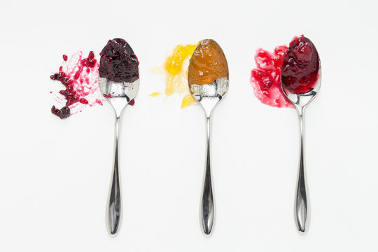 Mixed berry, apricot and sour cherry jam on spoons