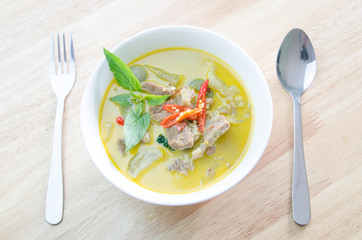 Green curry with pork   and fork spoon