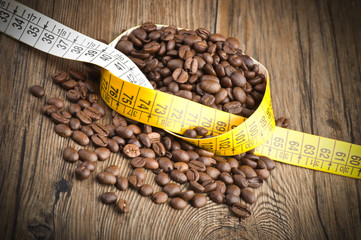 Wall Mural - Coffee beans and meter on the wood table