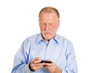 Senior elderly man reading bad text or email on mobile phone