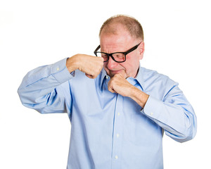 Is it me that stinks? Senior man smells armpit white background
