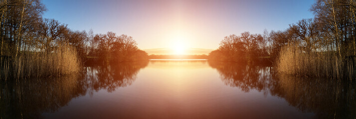 Photo Stands Deep brown Stunning Spring sunrise landscape over lake with reflections and