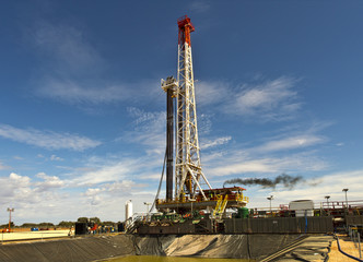 View of the land rig across the sump pit