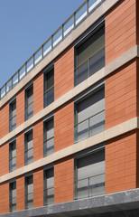 Building facade with blue sky.