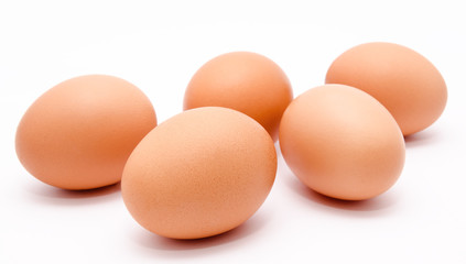 Five brown chicken eggs isolated on a white background