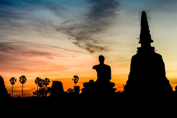 Silhouette of buddha after  sunset in Ayutthaya, Thailand