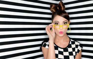 Attractive surprised young woman wearing glasse