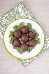 Chocolate profiteroles with cottage. Vertical photo. Macro.