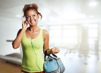 Young Woman in sport wear walking in gym