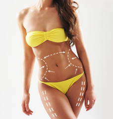 Beautiful and fit female body in a yellow swimsuit