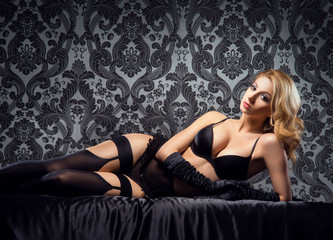 A beautiful woman in underwear relaxing in the bed