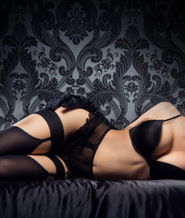 Sexy body of a young and beautiful woman in lingerie