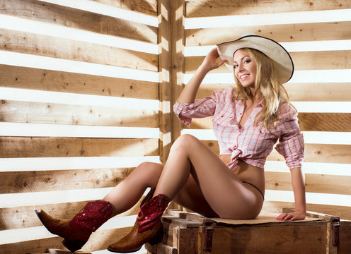 Sexy naked cowgirl in western style