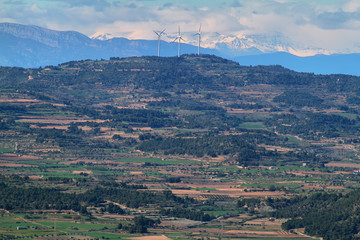 Distant view of pyrenees and windmills