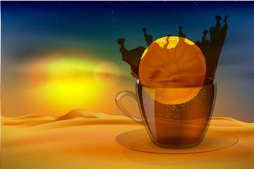 Splash of tea with lemon at sunset in the desert