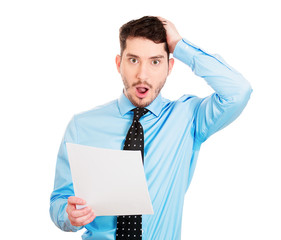 Expensive bills. Portrait upset shocked man holding papers