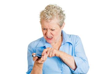 Angry senior woman having  phone conversation screaming