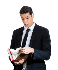 Money in books. Young business man politician receiving bribery