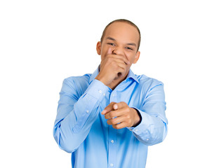 Man covering mouth, pointing and laughing